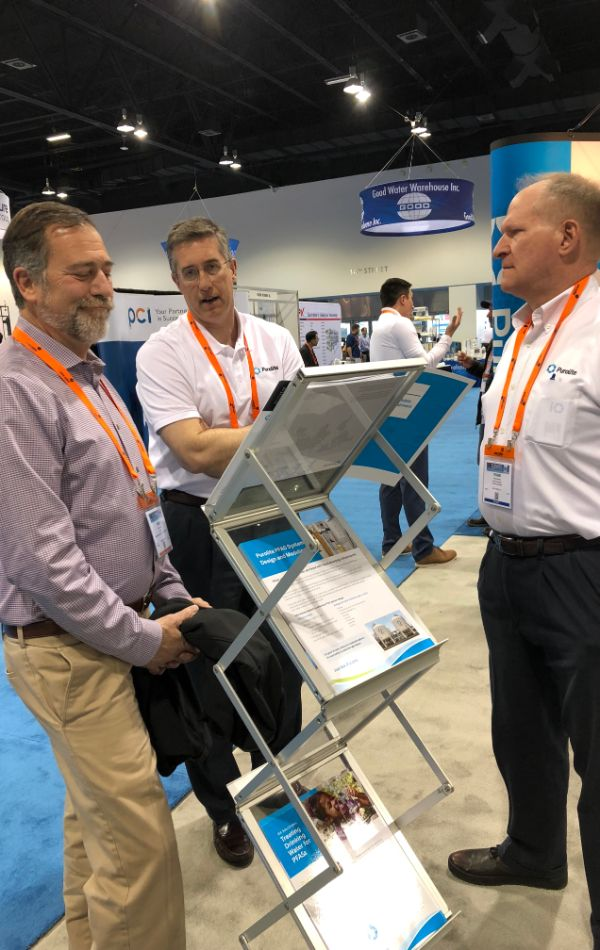 Frank and Jeffrey explaining Purolite products at WQA in Denver