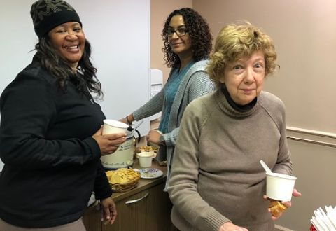 Gayle Victoria and Linda serving food