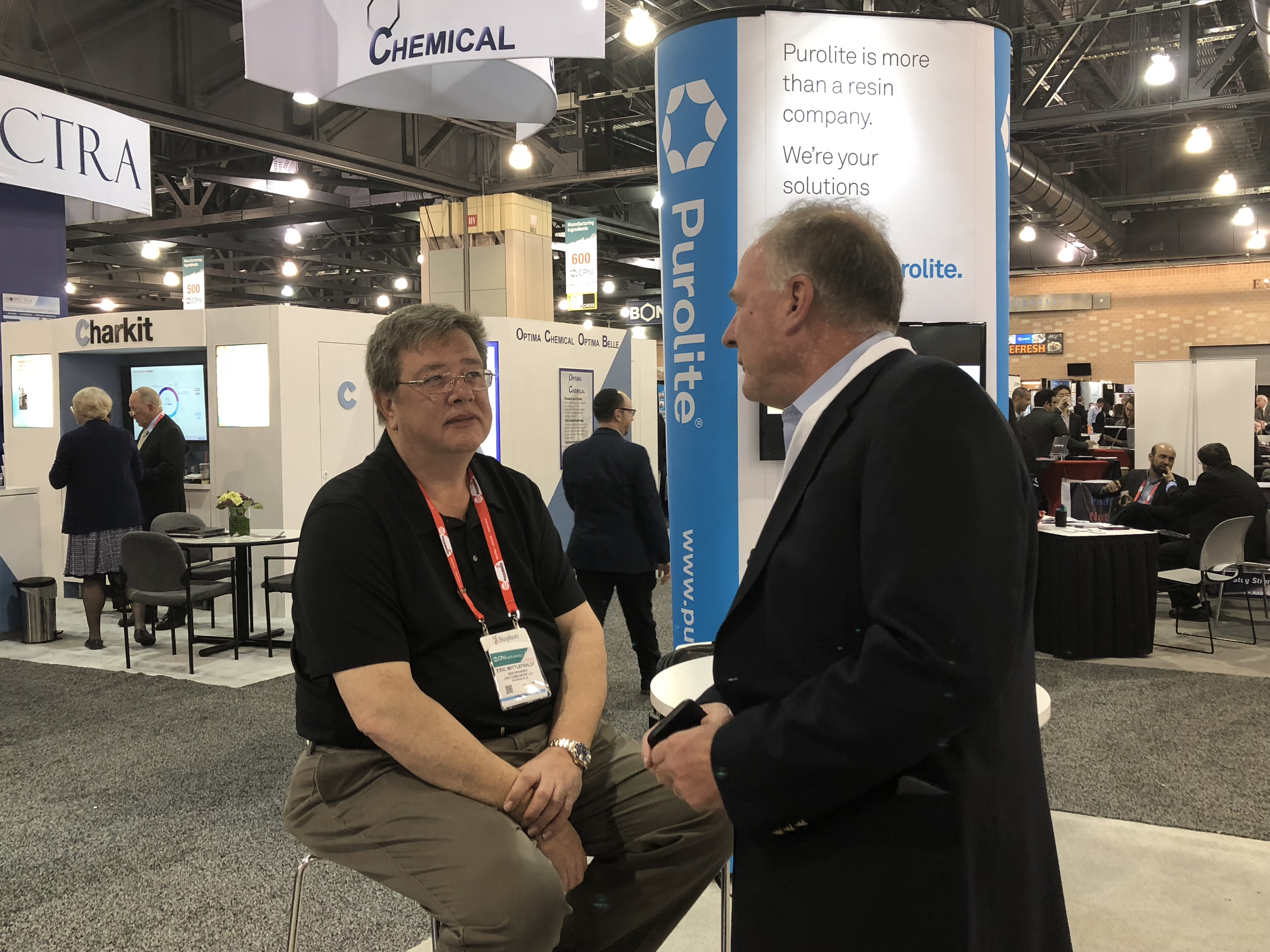 Jack speaking with a customer at CPhI